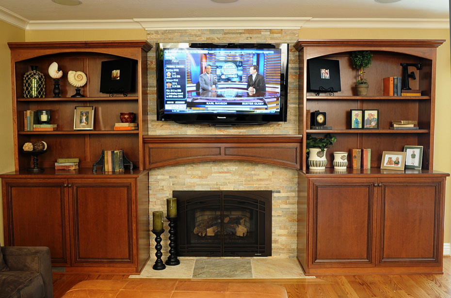 the wood connection cherry bookcases and fireplace mantel